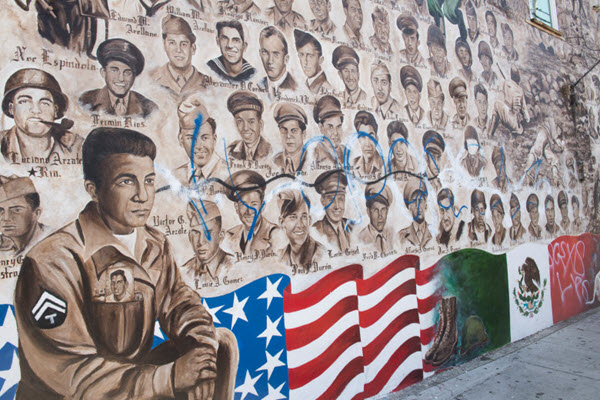 Santa Ana police, residents raise nearly $10,000 to fix defaced veterans mural