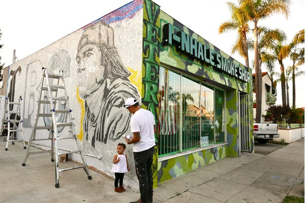 Artist honors hip hop history and Hispanic heritage with new mural in Long Beach