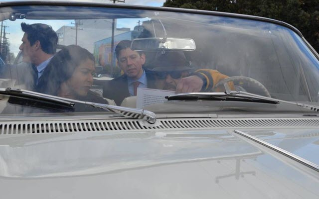 Lowriders squire Mayor London Breed around the Mission