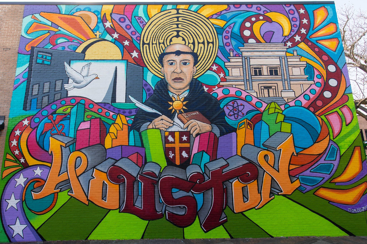 Catholic graffiti artist creates a giant St. Thomas Aquinas mural in Texas