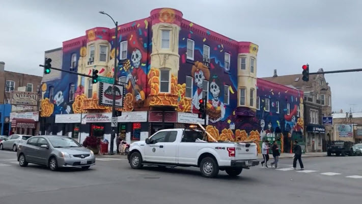 Huge Day of the Dead mural wraps around Little Village restaurant